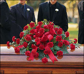 Red Regards Casket Spray from Bakanas Florist & Gifts, flower shop in Marlton, NJ